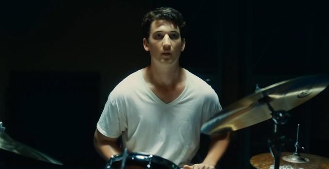 Miles Teller in the jazz drummer's uniform, a  sweaty v-neck (Whiplash)