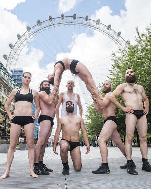 Performers from acrobatic troupe Barbu at a photocall in front of the London Eye, the Southbank - London